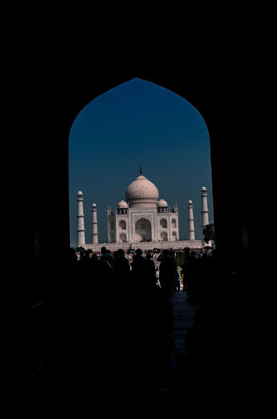 Taj Mahal Wonders Of The World Agra Arch Architecture Building Exterior Built Structure Clear Sky Day Dome Frame In Frame History Indoors  Indoors  Large Group Of People People Real People Silhouette Sky Tourism Travel Travel Destinations Vacations White Beauty