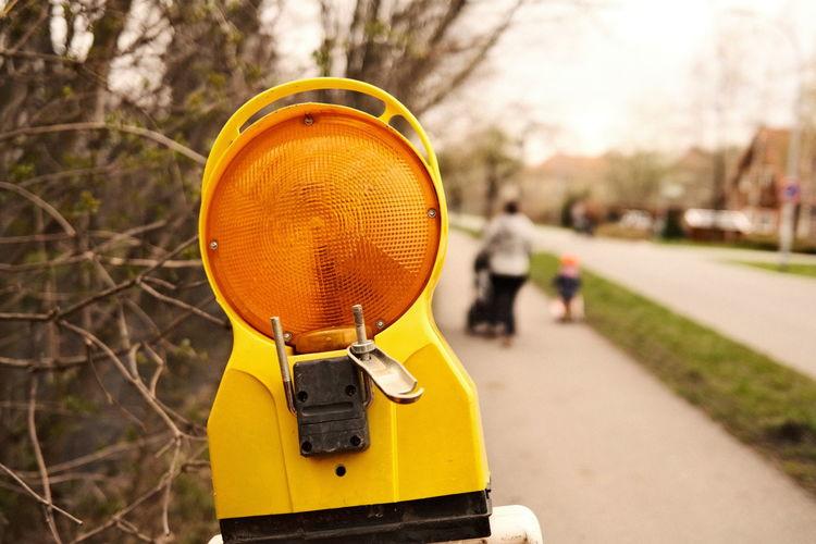Close-up of orange hat on road