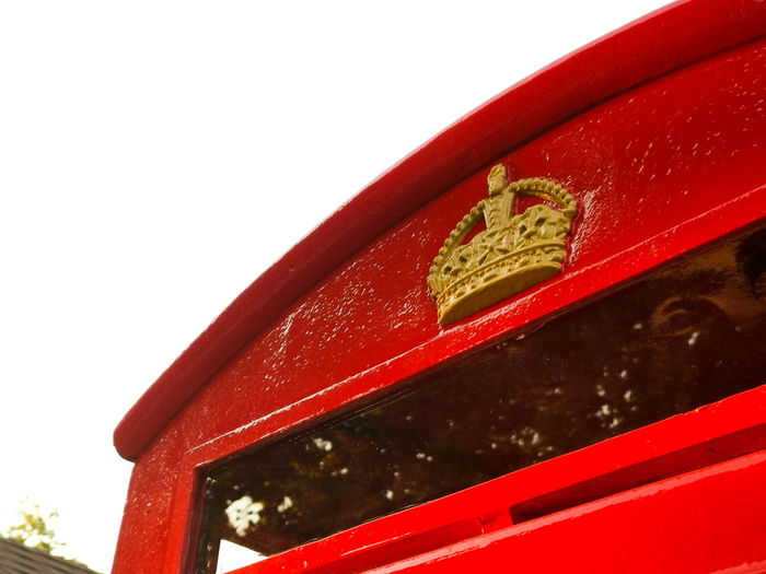 Close-up of red mailbox on white background