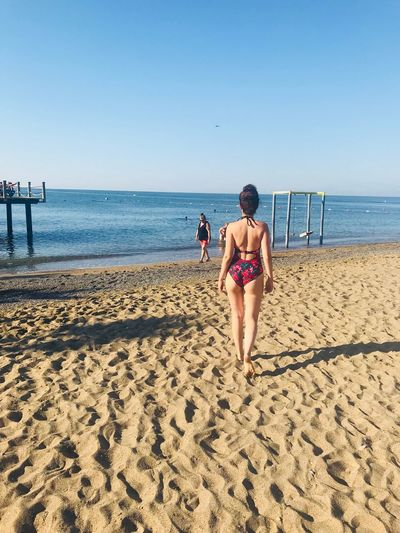 Vacations Summer Seascape Modeling Beach Beach Sea Land Sky Sand Water Real People Lifestyles Horizon Over Water Women Clear Sky Horizon Outdoors