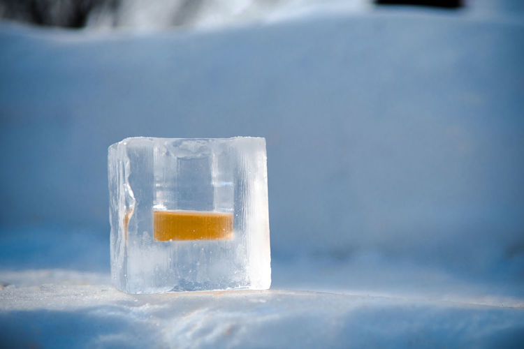 Close-up of drink in ice cube during winter