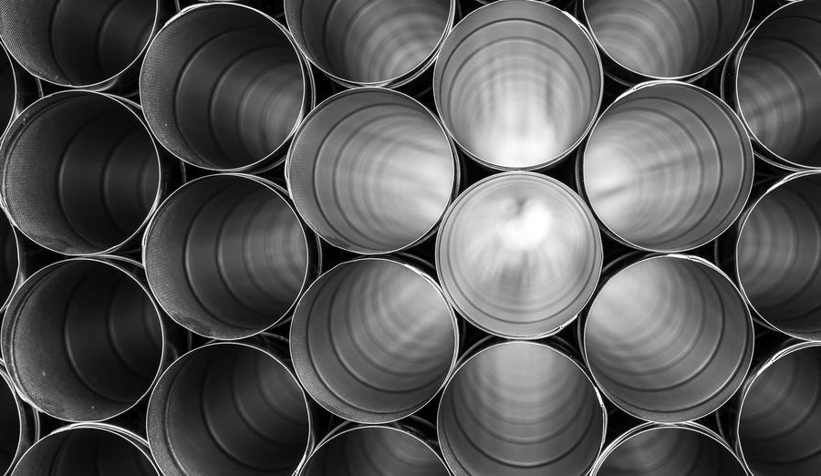 Metal Metal Industry Aluminum Pipes Industry Industrial Black And White Business Finance And Industry Products Man Made Structure Pattern Reflections Business Tubes Full Frame Large Group Of Objects No People Stack Backgrounds Repetition Pipe - Tube Abundance Close-up Arrangement Circle Geometric Shape Shape Still Life Man Made Object Order In A Row Steel Alloy