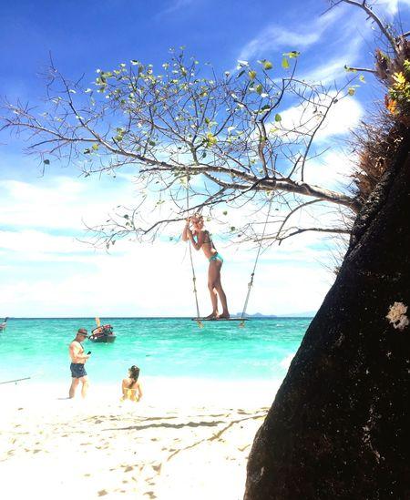 Girl on a swing Coolbreeze Blue Sky Beach