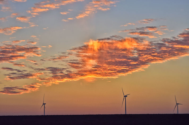Sunset Sky Renewable Energy Wind Turbine Alternative Energy Environmental Conservation Wind Power Environment Turbine Cloud - Sky Orange Color Scenics - Nature Silhouette Field Technology No People Sustainable Resources Power In Nature Outdoors