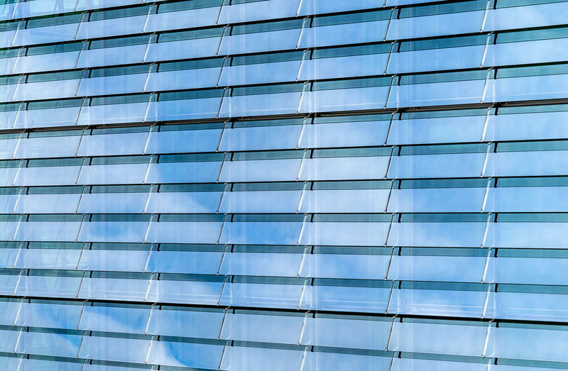 Futuristic Reflection Cloud - Sky Glass Lines Architecture Built Structure Building Exterior Office Building Exterior Building Office City Low Angle View Modern Full Frame Window Glass - Material No People Backgrounds Day Pattern Skyscraper Blue Nature Outdoors
