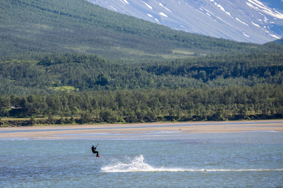 Adventure Adventure Club Arctic Beauty In Nature Blue Day Enjoyment Idyllic Jump Kitesurfing Landscape Leisure Activity Lifestyles Mountain Nature Northern Norway Norway Outdoors Scenics The Great Outdoors - 2017 EyeEm Awards Tourism Tree Unrecognizable Person Vacations Water