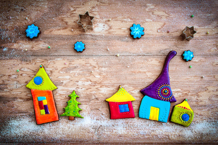 High angle view of colorful house shaped gingerbread cookies on table