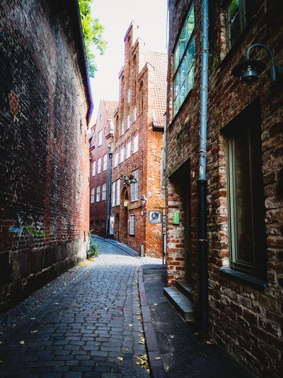 Lübeck Alley Architecture Brick Brick Building Building Building Exterior Built Structure City Day Direction Footpath Germany House Long No People Outdoors Residential District Row House Street The Way Forward Wall Wall - Building Feature