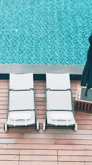 Chairs by swimming pool