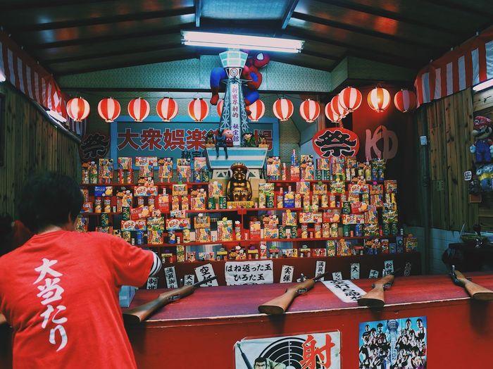 Man in illuminated store