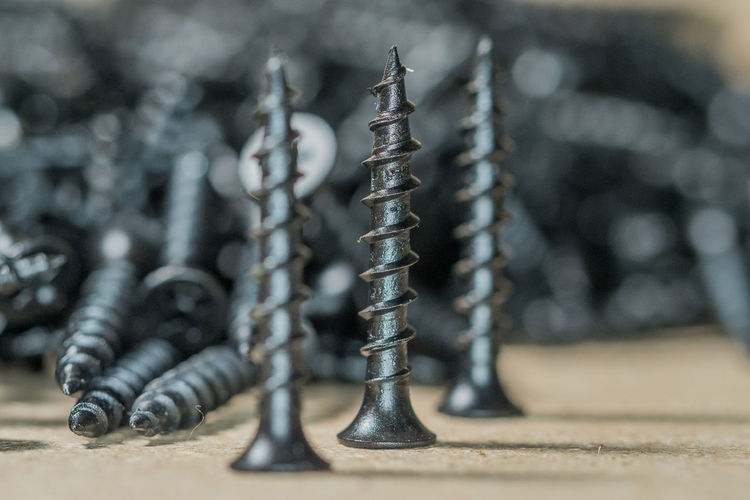 Aggression  Bolt Close-up Day Focus On Foreground Group Of Objects In A Row Indoors  Large Group Of Objects Metal No People Nut - Fastener Screw Selective Focus Silver Colored Still Life Table Work Tool