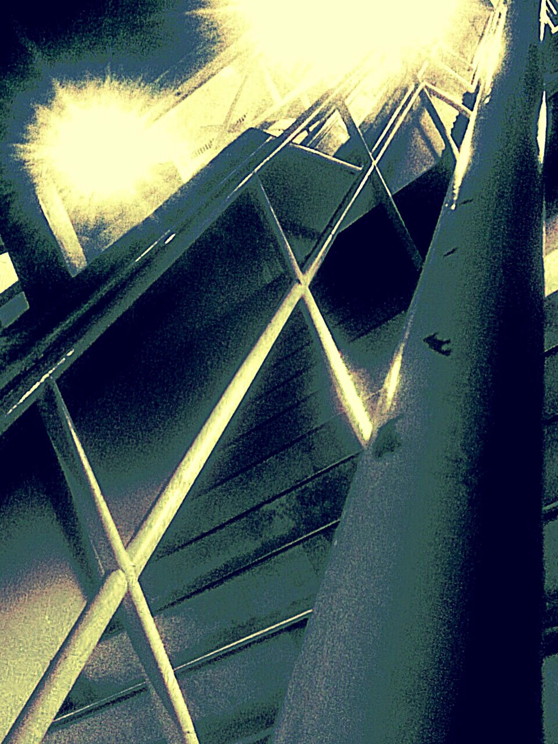 low angle view, sun, sunlight, lens flare, sunbeam, built structure, railing, metal, pattern, sky, architecture, no people, sunny, outdoors, bridge - man made structure, close-up, staircase, steps, shadow, day