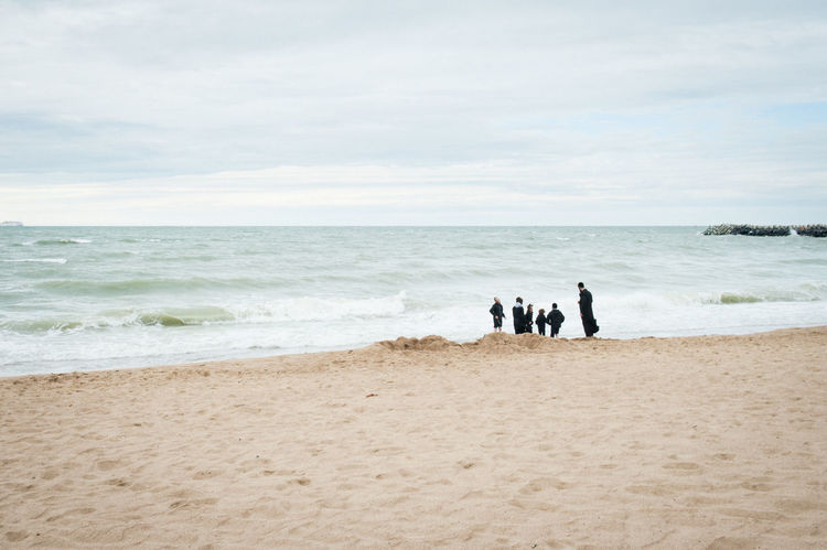 Group of people on beach with rabbi and jewish child student Beach Belgium Child Cloud - Sky Cold Europe Horizon Over Water Jewish Oostende, Belgium Ostend Outdoors People Pupil Rabbi Religion Sand Sea Sky Student Water