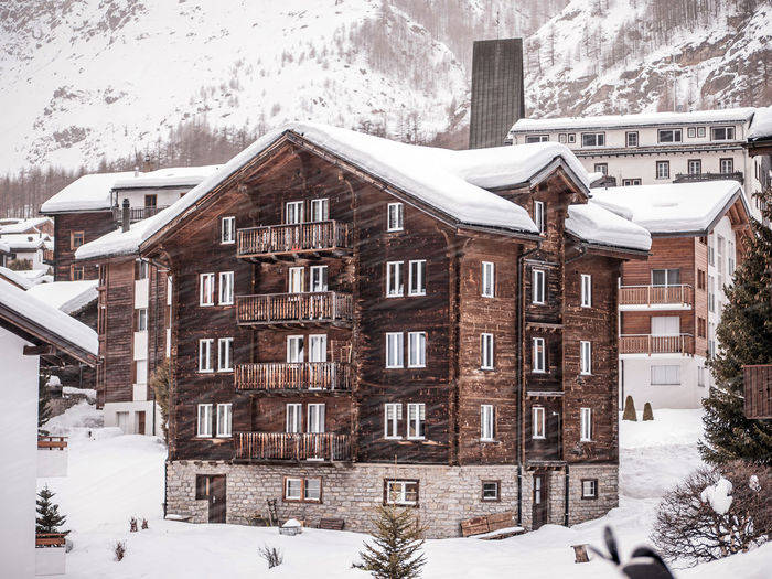 Snow covered residential buildings in city