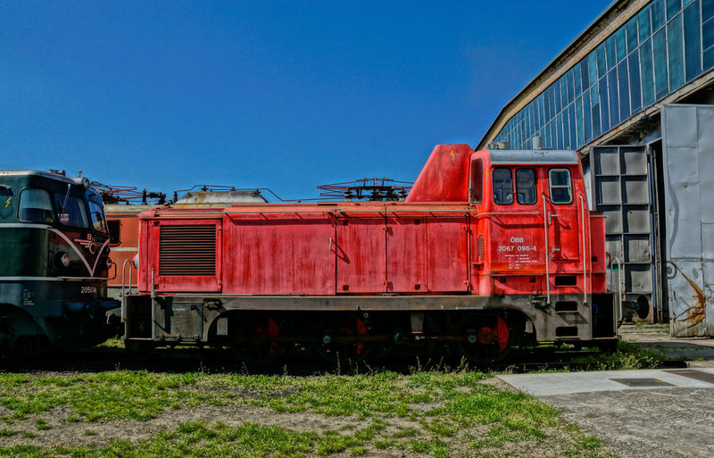 Side View Of Trains At The Depot