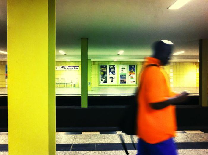 Subway platforms with black man passing Berlin subway Platform Black man Passing By