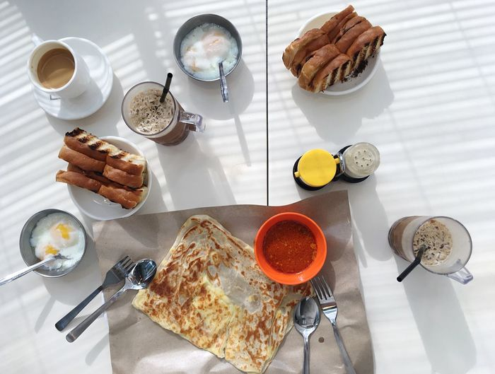 Roti Prata in Singapore Roti Prata Food And Drink Food Table Ready-to-eat Freshness High Angle View Eating Utensil Breakfast Coffee - Drink Meal Coffee Bread