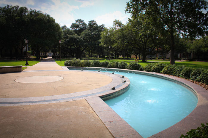 A view of the campus grounds at Southwestern University in Georgetown, Texas. Campus Fountain Texas Back To School Beauty In Nature College Day Growth Hill Country Nature No People Outdoors Sky Summer Tranquility Tree University Water