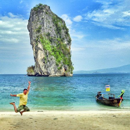 Sea Beach Water Sand Shore Vacations Leisure Activity Lifestyles Sky Transportation Cliff Casual Clothing Tourism Cloud - Sky Beauty In Nature Scenics Tourist Person Non-urban Scene Tranquility