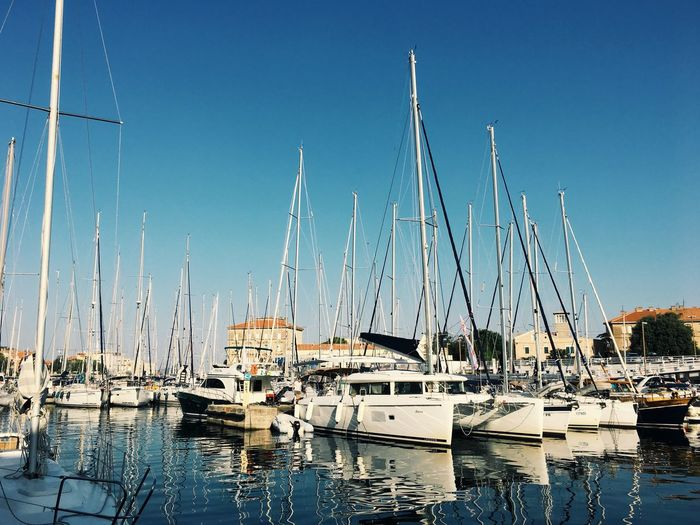 Nautical Vessel Moored Transportation Mode Of Transport Mast Clear Sky Harbor Water Boat Blue No People Sailboat Marina Day Outdoors Sunlight Sea Yacht Architecture Travel Destinations