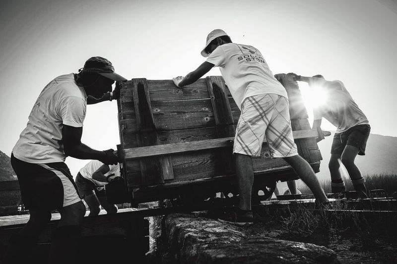 Hard work at fields of salt. Working Men Occupation Sunlight Teamwork Manual Worker Real People Day Full Length Outdoors Young Adult Sky Adult Only Men People Adults Only The Week On EyeEm