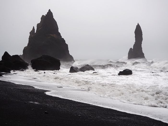Iceland Volcanic  Black Sand Beach Volcanic Landscape Sea Beach Water Land Sky Scenics - Nature Beauty In Nature Nature Rock Tranquility Tranquil Scene Rock Formation Solid No People Rock - Object Idyllic Day Non-urban Scene Sand Horizon Over Water