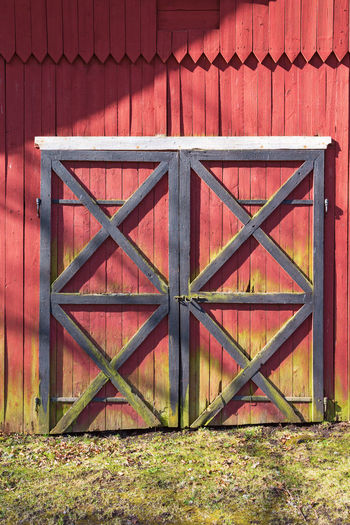 Closed metal gate of red building