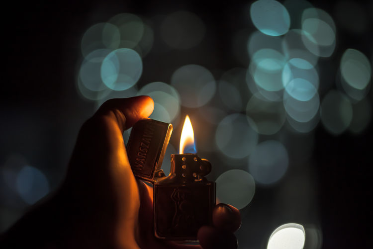 Burning Candle Cigarette Lighter Close-up Flame Glowing Heat - Temperature Holding Human Body Part Human Finger Human Hand Illuminated Lifestyles Night One Person Outdoors People Personal Perspective Inner Power