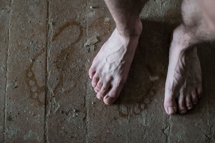 Human Body Part Low Section Body Part Human Leg One Person barefoot Real People Human Hand Men Standing Indoors  Human Foot Dirty Hand Limb Human Limb
