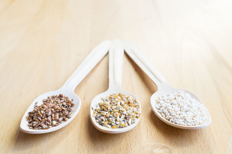 Cereal Flaxseed Quinoa Spoon Amaranth Bowl Cereals Close-up Crop  Day Food Food And Drink Freshness Grain Healthy Healthy Eating Healthy Food Healthy Lifestyle Indoors  No People Spoons Superfood Table Three Wooden Background