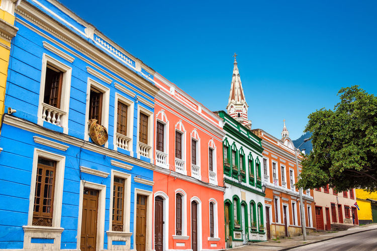 Colorful buildings against clear blue sky at la candelaria