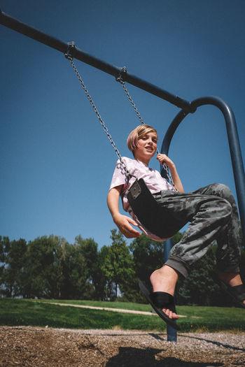 Full length of girl on swing at playground
