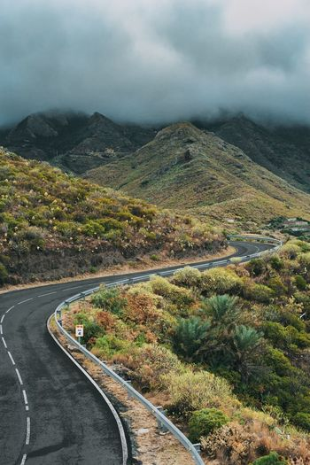 Curved empty road in picturesque mountain landscapes at sicily, italy.