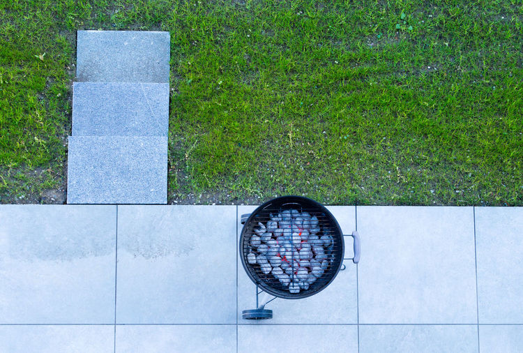 Day Plant No People Green Color Nature Grass High Angle View Outdoors Directly Above Geometric Shape Stone Shape Flooring Circle Tile Concrete Grilling Grill Coal Embers Coal Grill Springtime