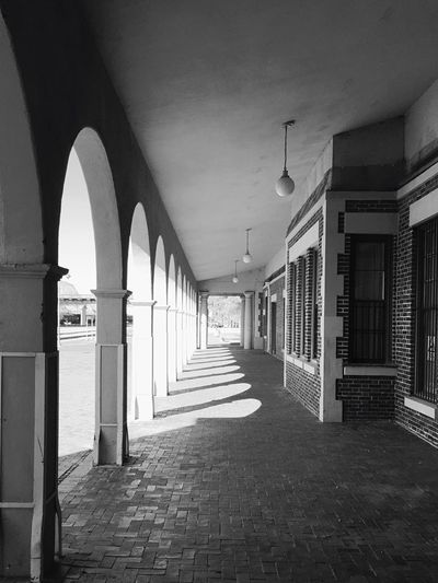 """""""Bygone Days"""" Columns along an outside walkway at the historic Barstow Harvey House 'Casa Del Desierto' which opened in 1911 and closed in 1971. Route 66 Harvey House Historical Building Historic Hotel Blackandwhite Blackandwhite Photography"""