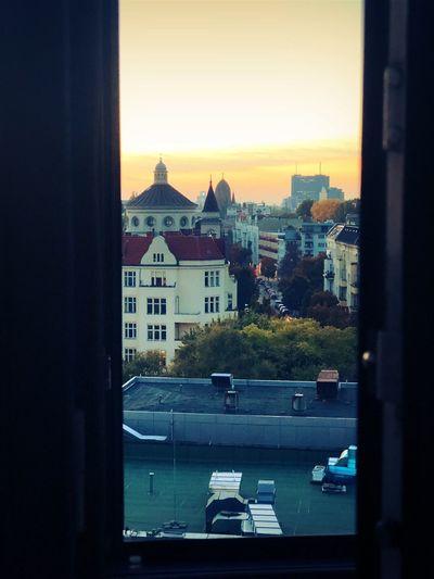 Buildings in city seen through glass window