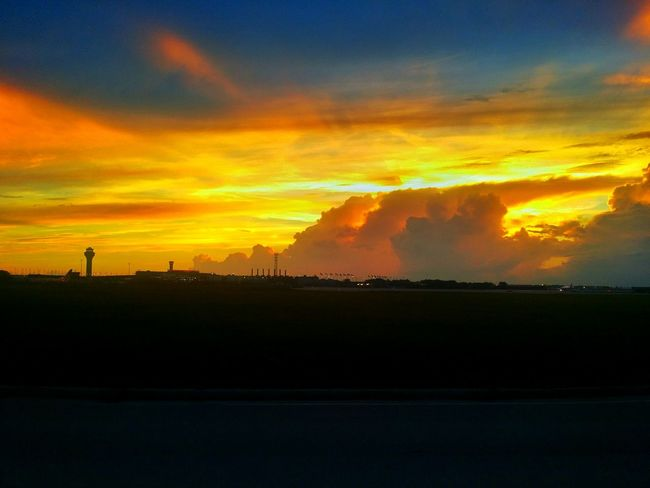 Sunset Scenics Silhouette Cloud - Sky Orange Color Landscape Sky Tranquil Scene Beauty In Nature Tranquility Nature Cloud Dramatic Sky Outdoors Cloudy Majestic Calm Storm Cloud Dark Outline Airport Ohare International Airport
