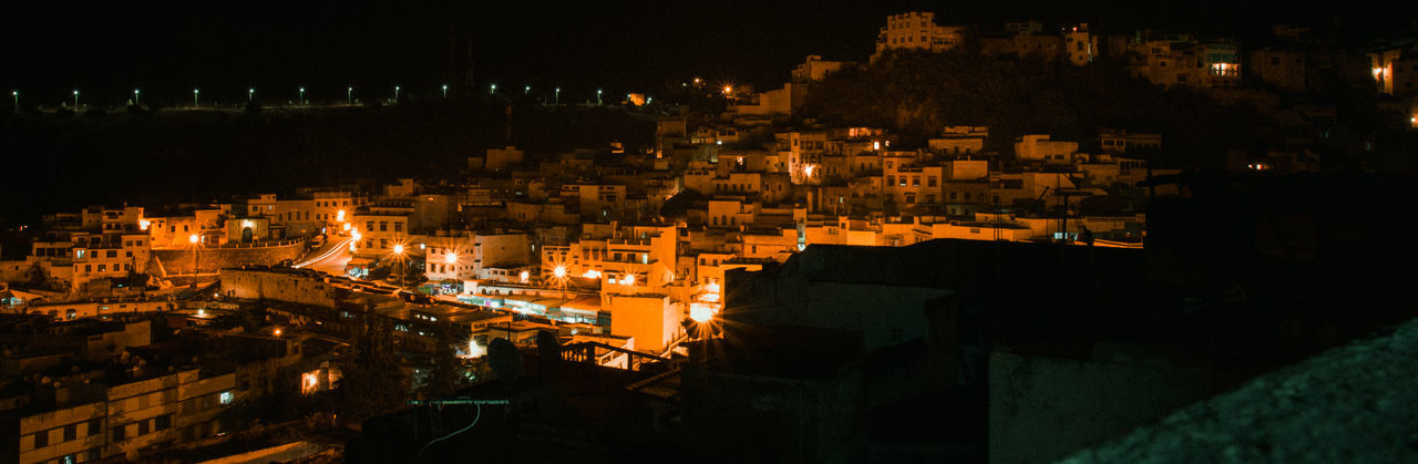 Just a piece of humanity Morocco Maroc Nightfall Nightphotography Night City Cityscape Illuminated Urban Skyline Nightlife Arts Culture And Entertainment Sky Architecture TOWNSCAPE Rooftop Housing Settlement Residential Structure Old Town Place Of Interest