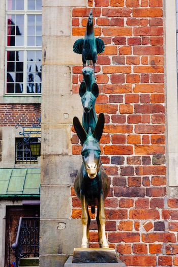 A sculpture of the Town Musicians of Bremen in Germany. Bremen Fairytale  Germany Sculpture Statue Town Musicians Of Bremen Travel