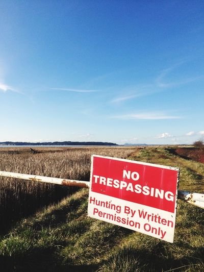 No hunting Warning Sign Text Field No People Nature Day Communication Outdoors Sky Rural Scene Tranquility Forbidden Beauty In Nature Landscape Grass Agriculture Sign Hunting Open Warning No Hunting