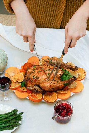 High angle view of girl preparing food on table