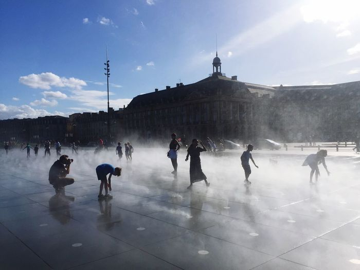 Miroir D'eau - Bordeaux Bordeaux Large Group Of People Real People Architecture Leisure Activity Built Structure Men Sky Mixed Age Range Lifestyles Women Cloud - Sky Day Building Exterior Outdoors Water Nature City Ice Rink People