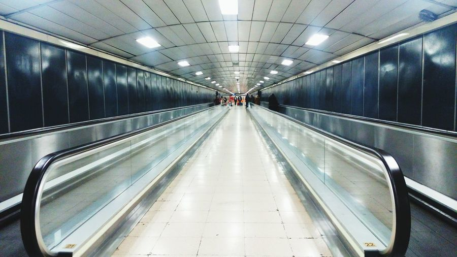 Moving Walkway In Illuminated Building
