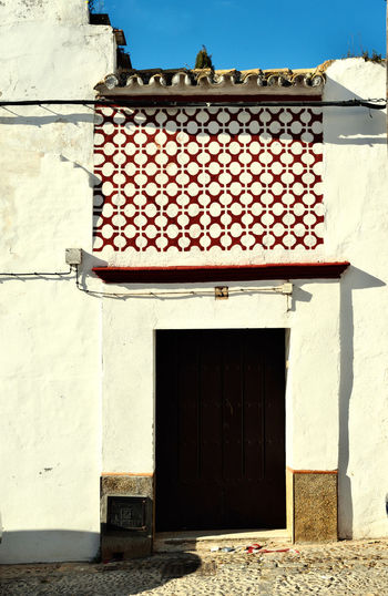 facade Andalusian home with decoration of ceramic tiles Andalusia Architecture Building Exterior Ceramic Door Entrance Façade House No People Ornaments Wall