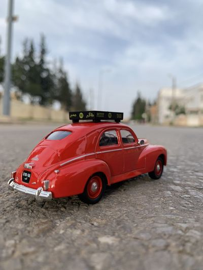 Red toy car on road