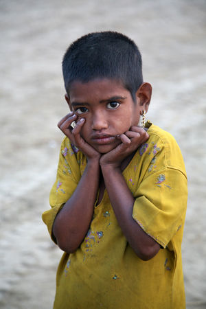 Portrait of girl on street on January 14, 2009 in Kumrokhali, West Bengal, India. ASIA Beggar Child Desperate Dirty Girl Helpless Homeless Hopeless Hunger Hungry India Juvenile Kid Kumrokhali Little Looking At Camera Miserable Person Poor  Portrait Poverty Sad Slum West Bengal