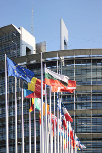 European Parliament in Strasbourg, France Building Exterior Built Structure Architecture Flag Building No People Multi Colored Low Angle View Day Nature Patriotism Clear Sky Sky Outdoors City Modern Variation Window Wind European Union European Parlament European Parliament