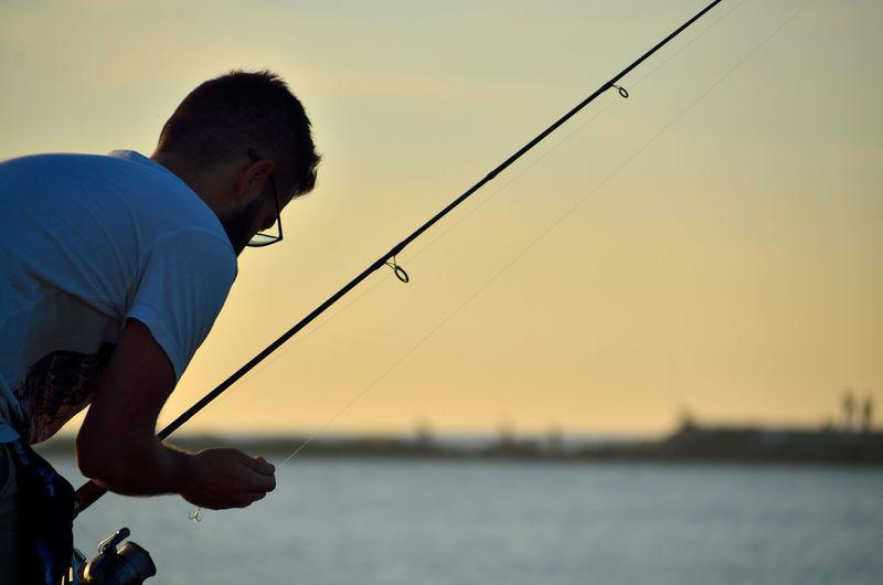 Fisherman preparing the bait