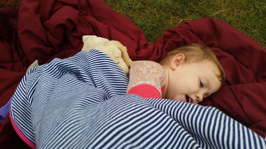From the soccer game earlier. She was hiding from the wind. Sisters Soccer Moms Snuggles Toddlers