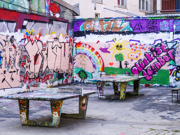URBANANA #urbanana: The Urban Playground Architecture Art And Craft Available Light Bench Building Exterior Built Structure City Creativity Day Footpath Graffiti Messy Multi Colored Mural No People Outdoors Paint Seat Sidewalk Street Street Art Streetphotography Wall Wall - Building Feature